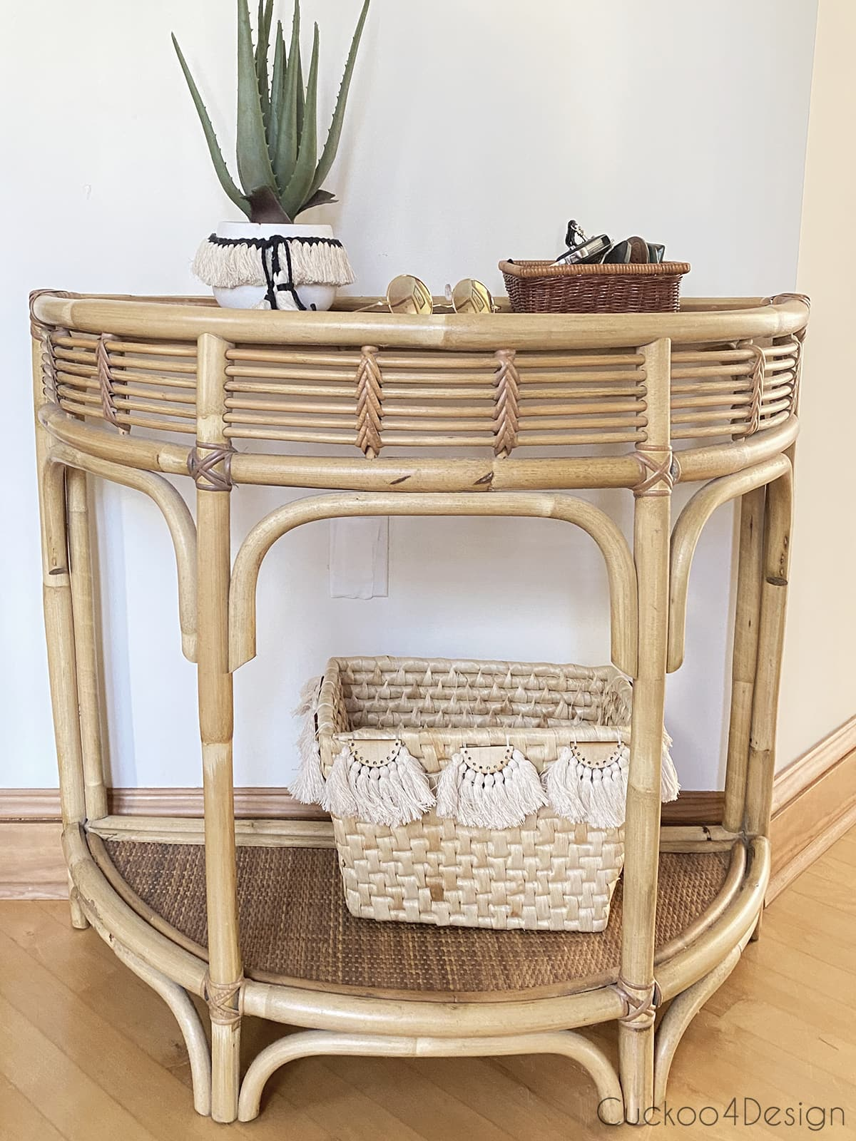 basket with embellishments on rattan console