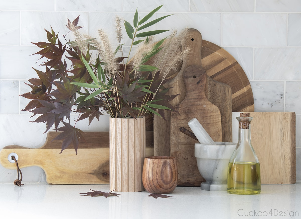 wooden fluted vase mixed with wooden cutting boards
