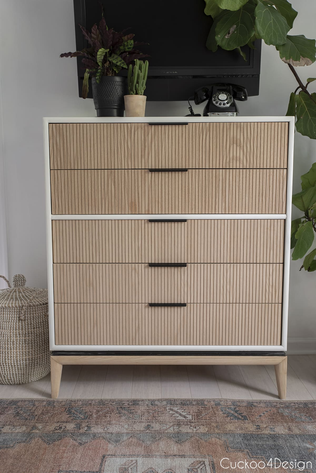 close-up full frontal view of dresser with oak fluted molding