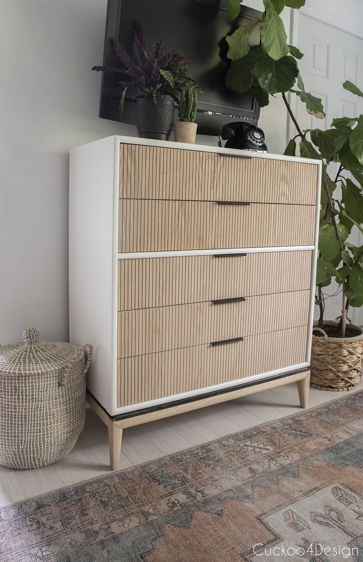 side view of painted dresser body with fluted drawers