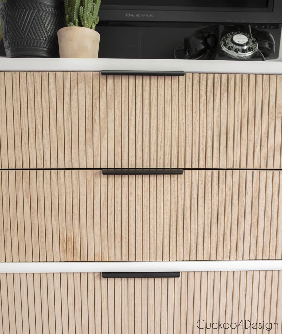 close-up of fluted molding with drawer pulls