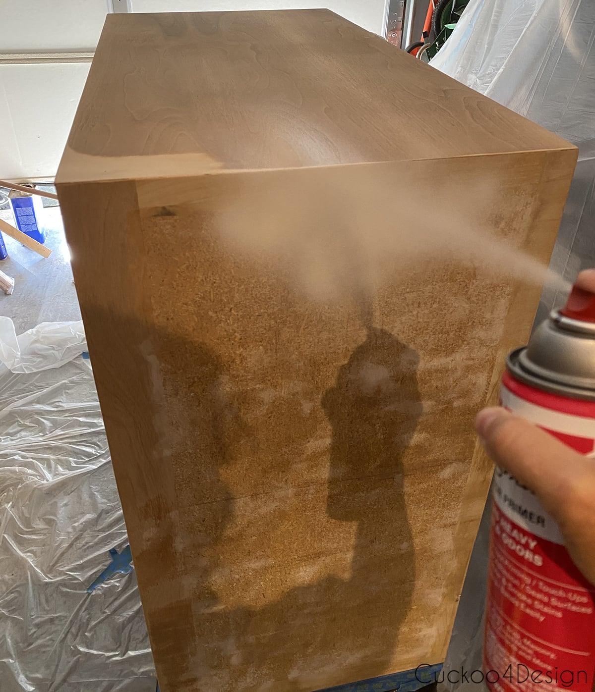 spraying kilz primer on dresser