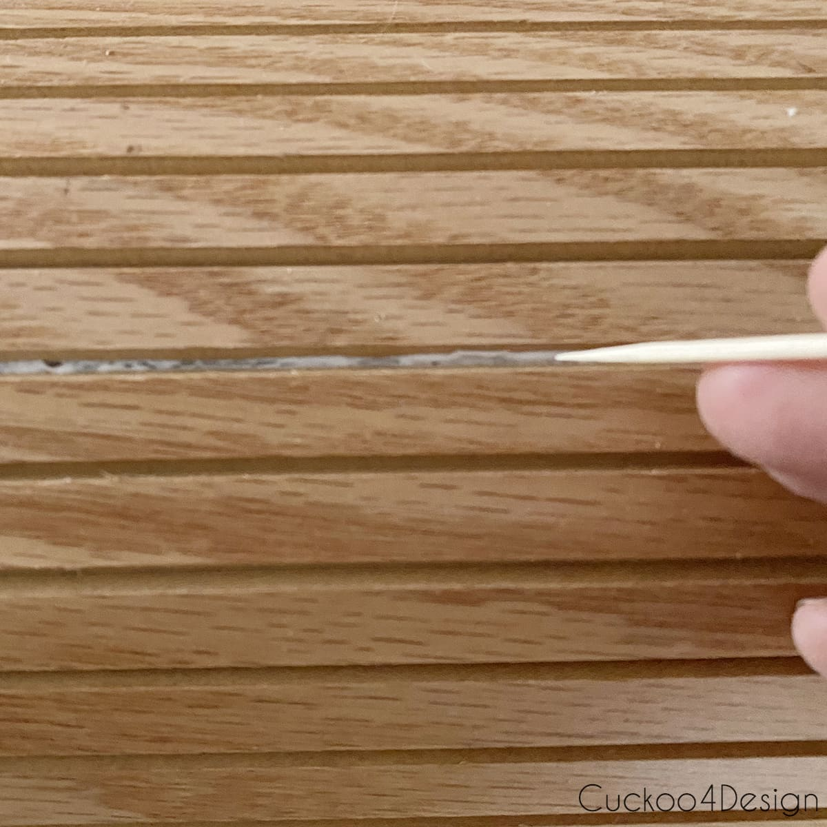 cleaning seam of fluted molding with toothpick