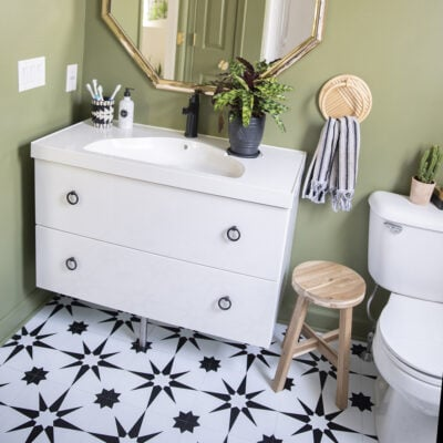 Our bathroom makeover with black and white peel and stick floor tile