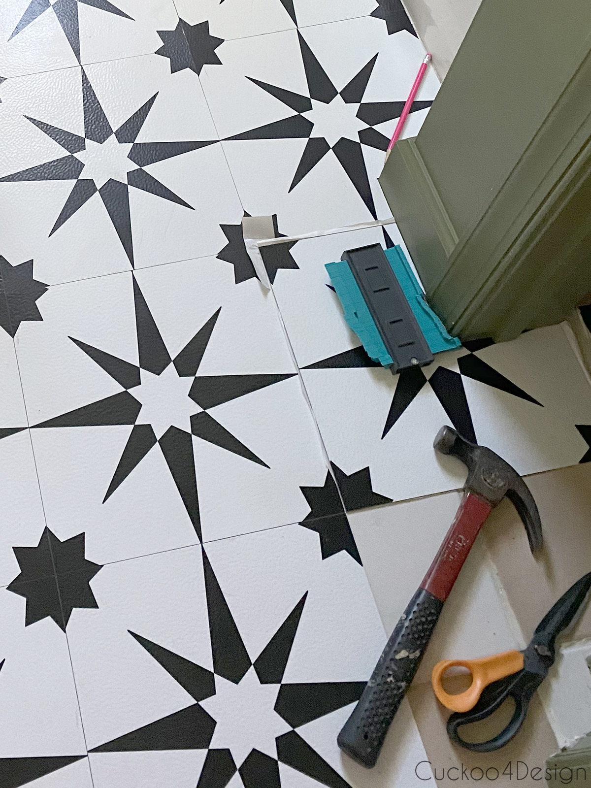 using a profile tool to cut cheap peel and stick floor tile
