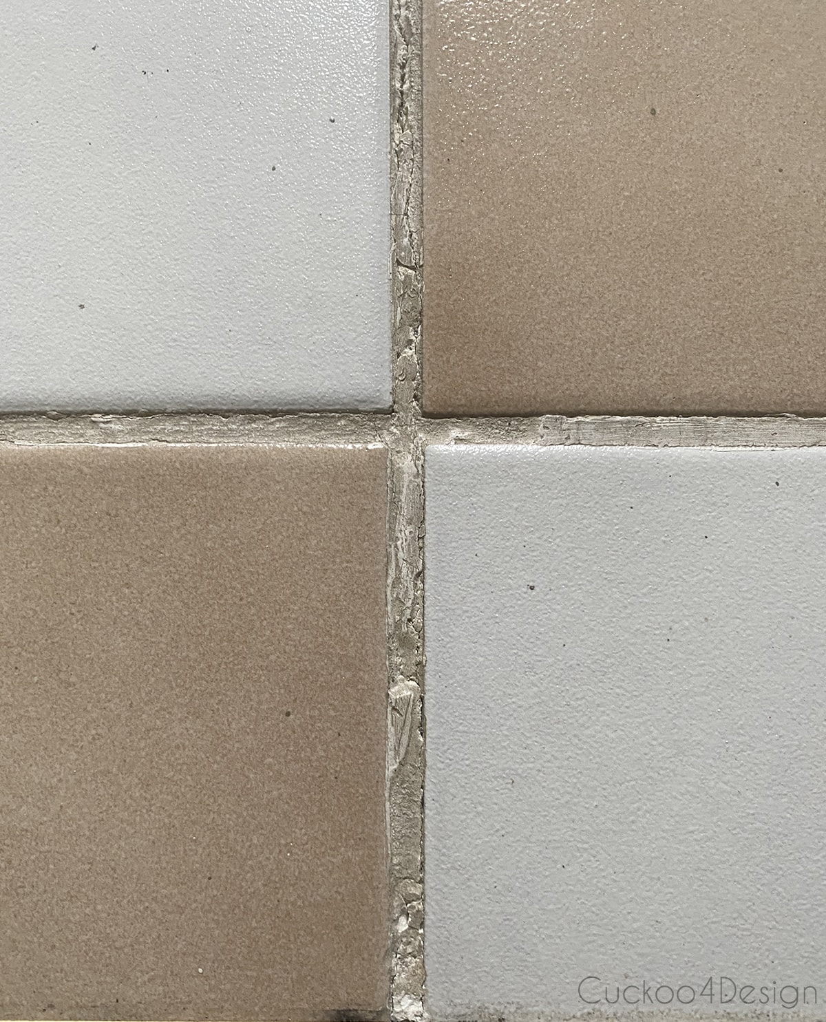 damaged grout on old ceramic tile
