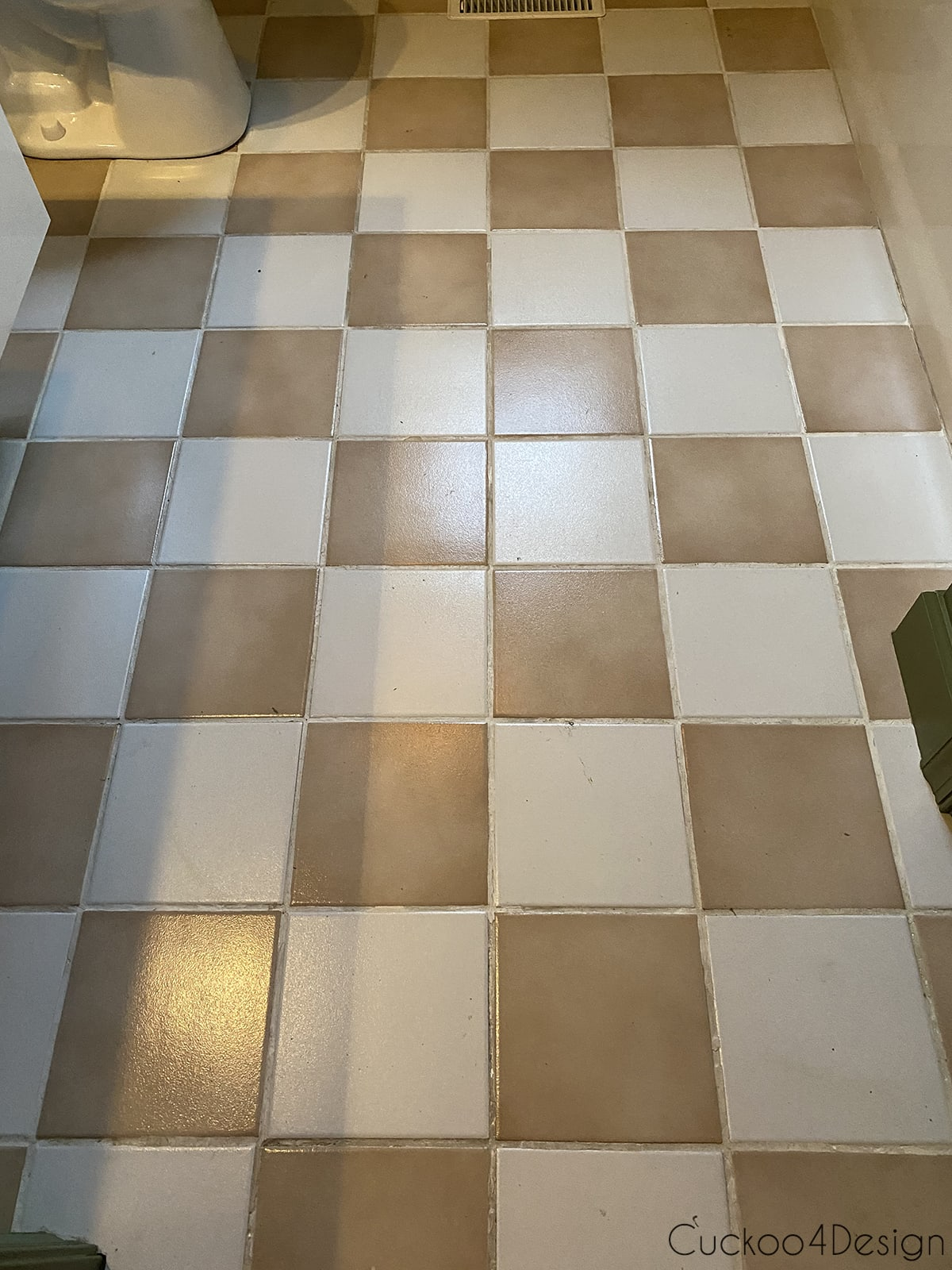 view from above of entire old ceramic floor before applying cheap peel and stick floor tile
