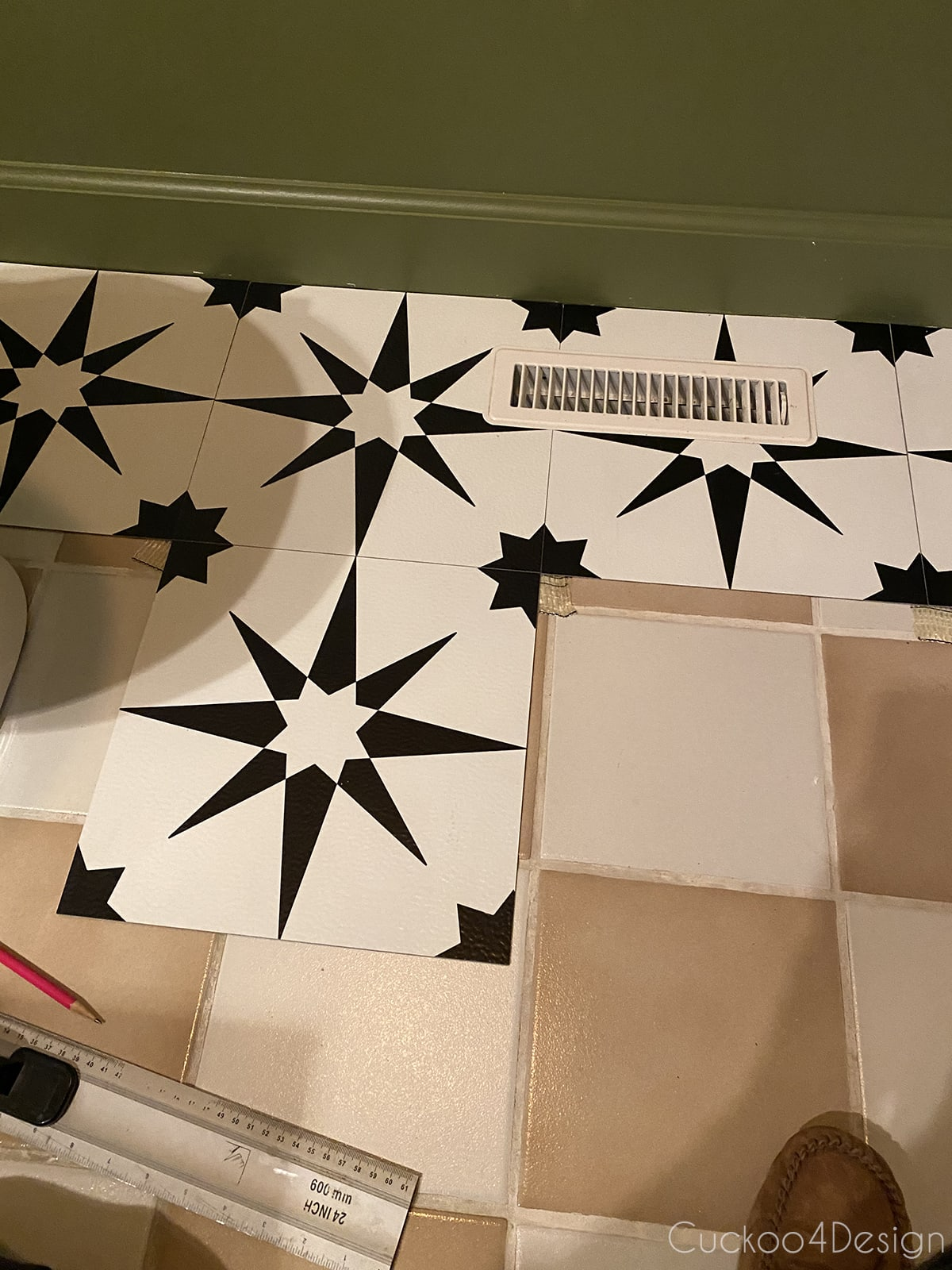 view of pattern progress on cheap peel and stick floor tile