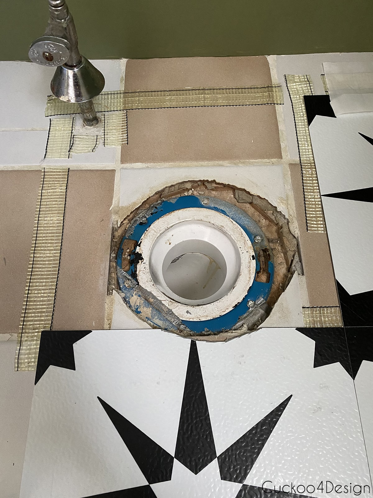 view of carpet tape around toilet before applying cheap peel and stick floor tile