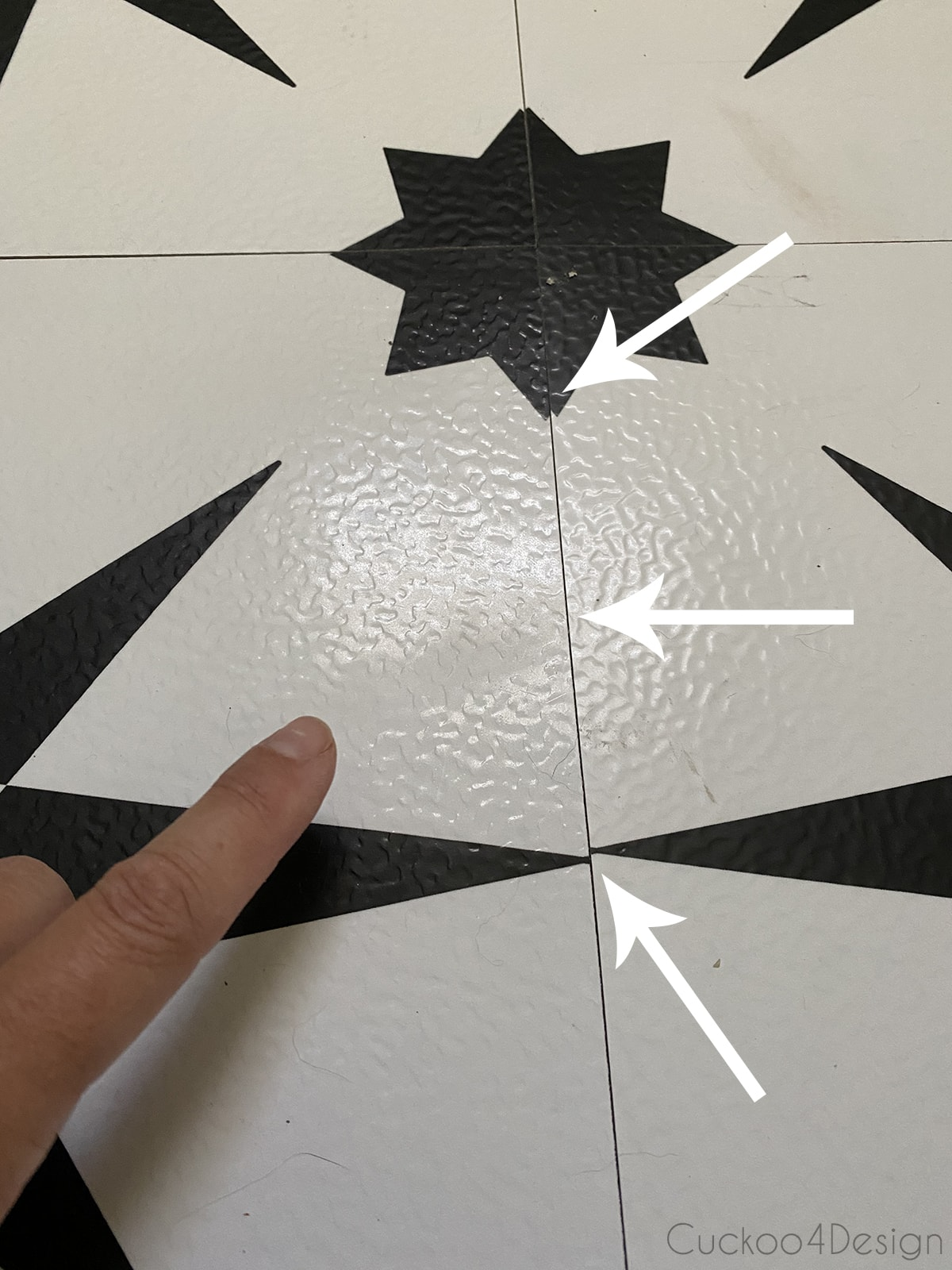 closeup of cheap peel and stick floor tile where the pattern doesn't match up
