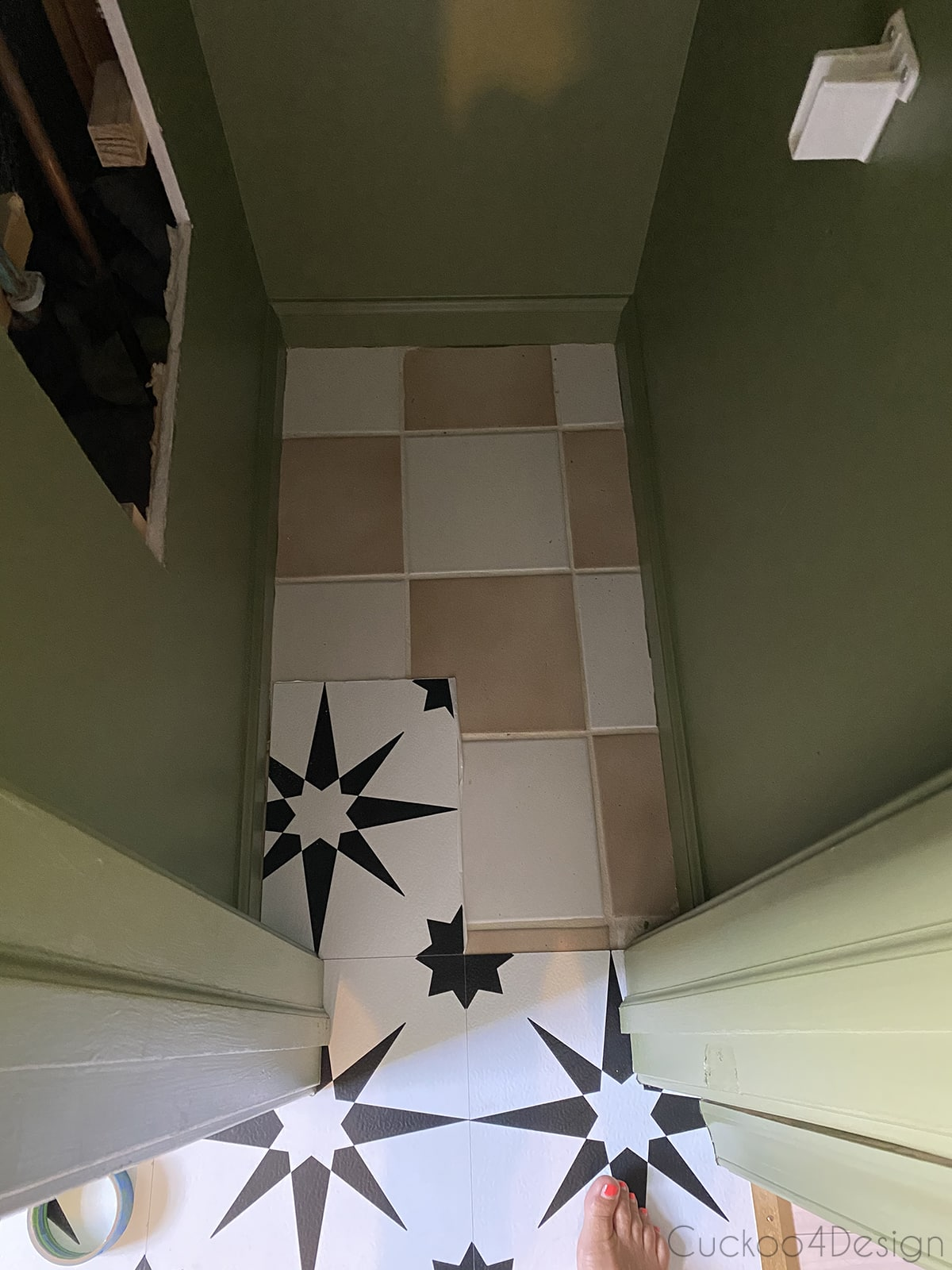 fitting cheap peel and stick floor tile inside the letterbox closet