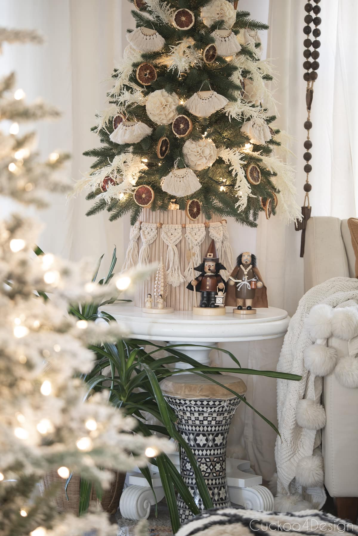 view of fluted planter under boho christmas tree