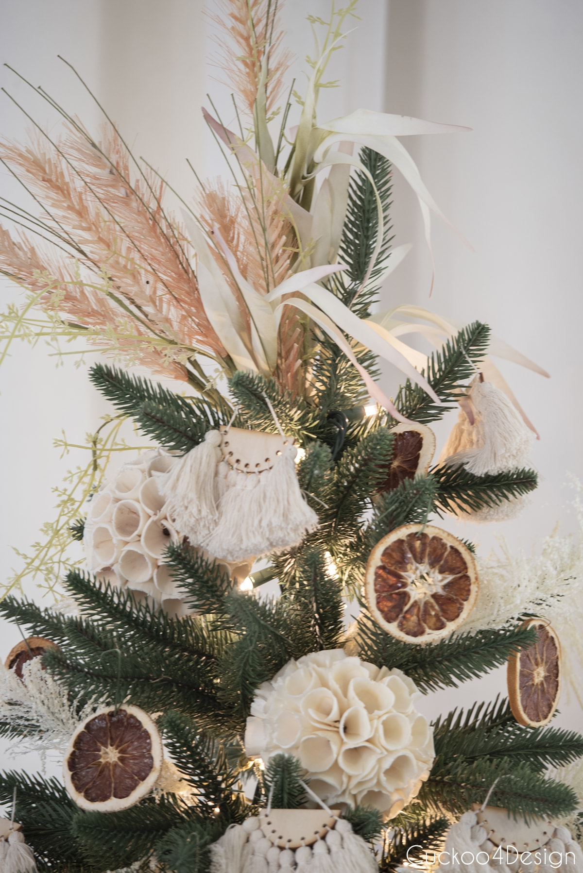 close up of grass tree topper on boho Christmas tree