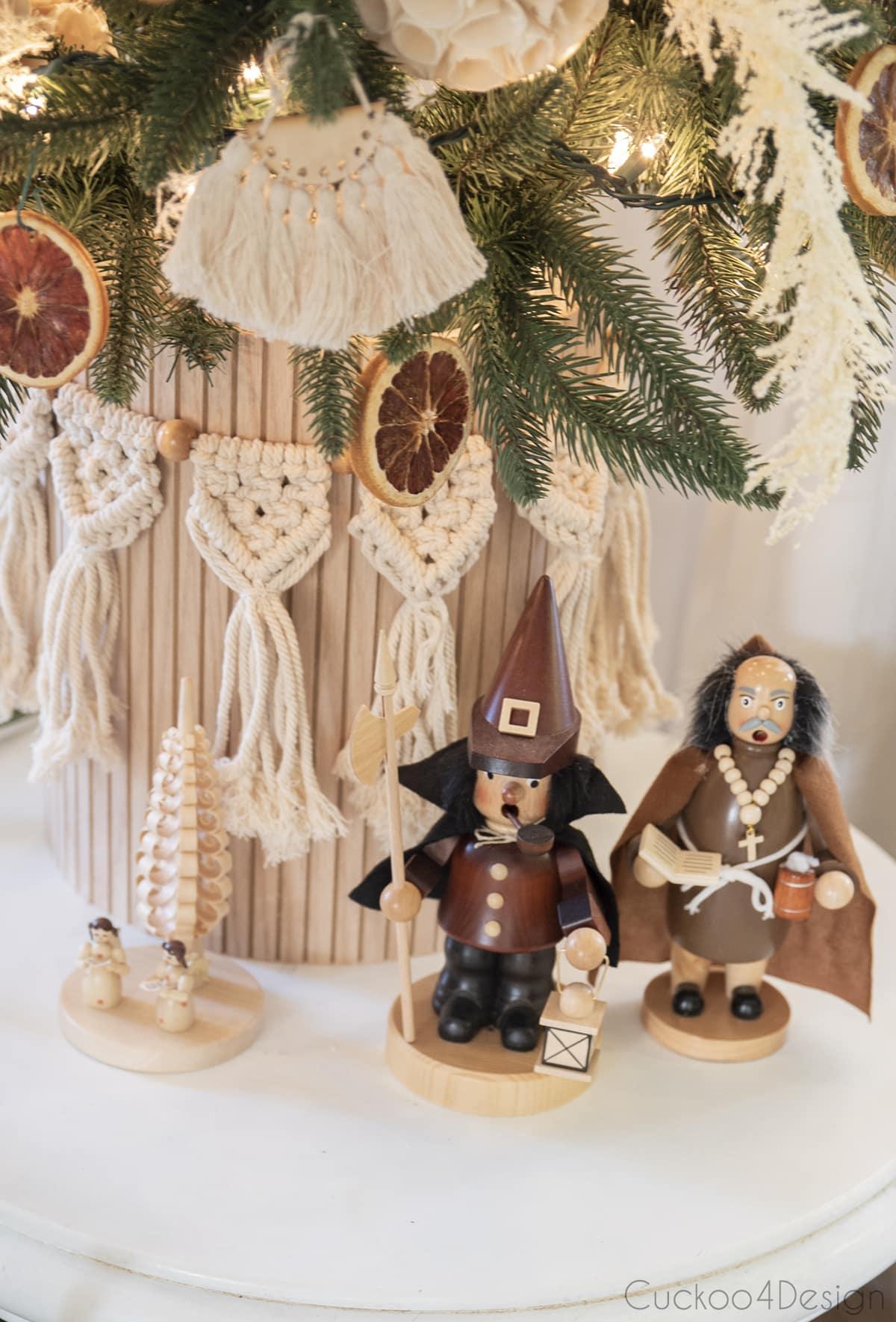 wood toned German smokers under boho Christmas tree