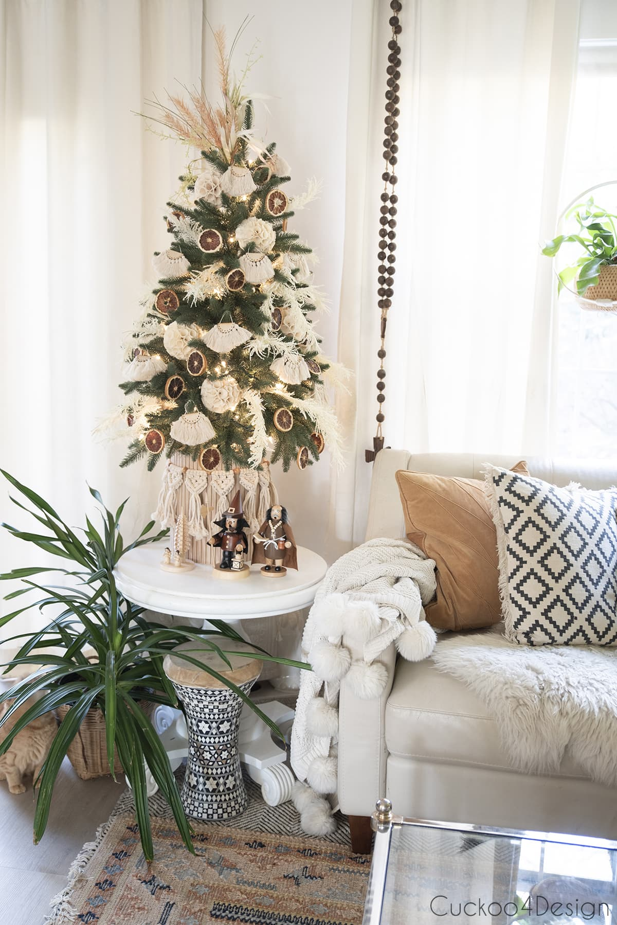 mustard toned pillows and rug with boho Christmas tree