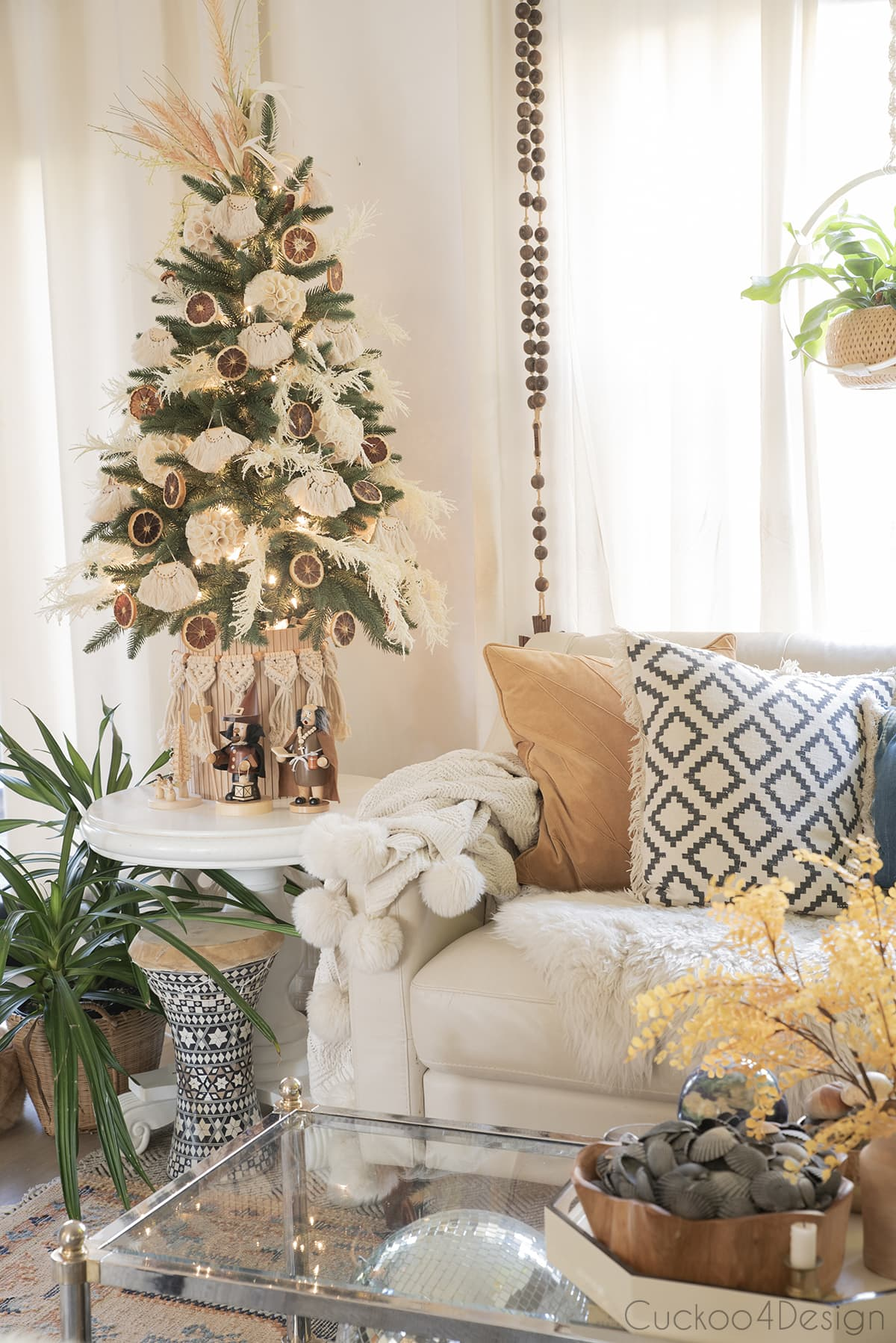 side view of boho christmas tree with grasses and macrame