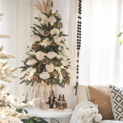 Neutral boho Christmas tree with macrame, grasses and orange slices