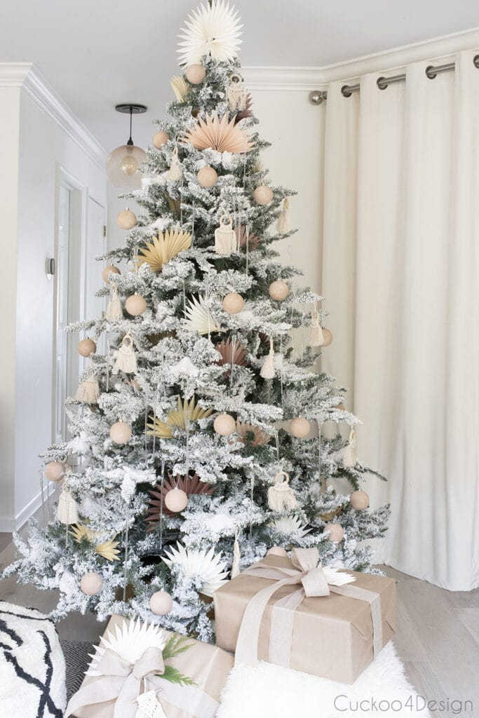 pastel flocked Christmas tree with lights off so you can see baking soda paint Christmas ball ornaments