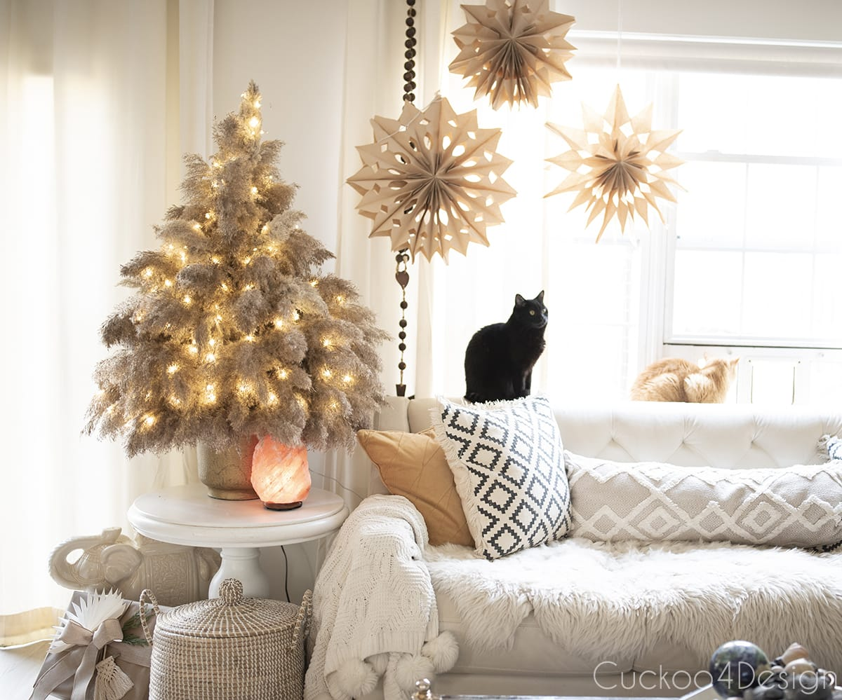 black cat sitting with pampas grass Christmas tree