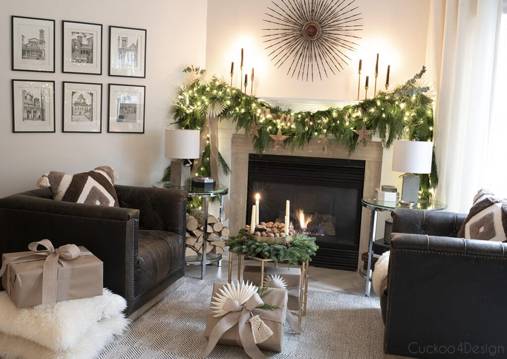 fireplace mantle with leather swivel chairs and fairy light garland