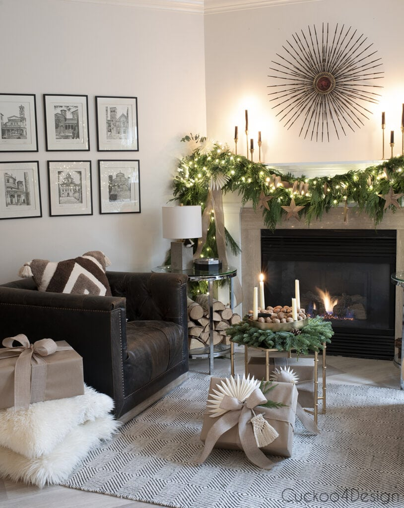 natural advent wreath by fireplace with fairy light garland on mantle