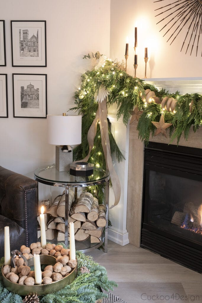 fireplace garland with wood beads and plug-in fairy lights