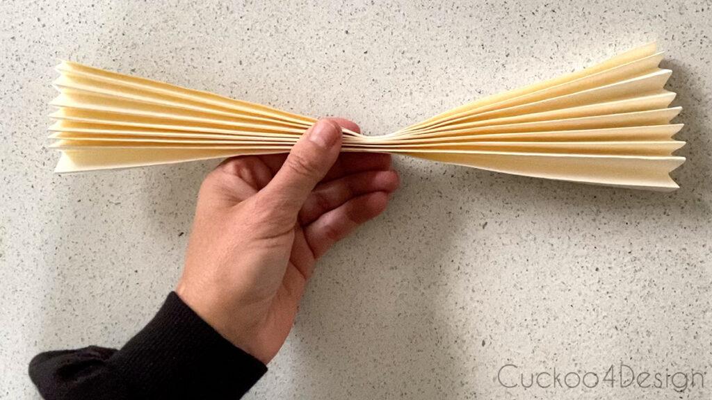 folding paper fan in half