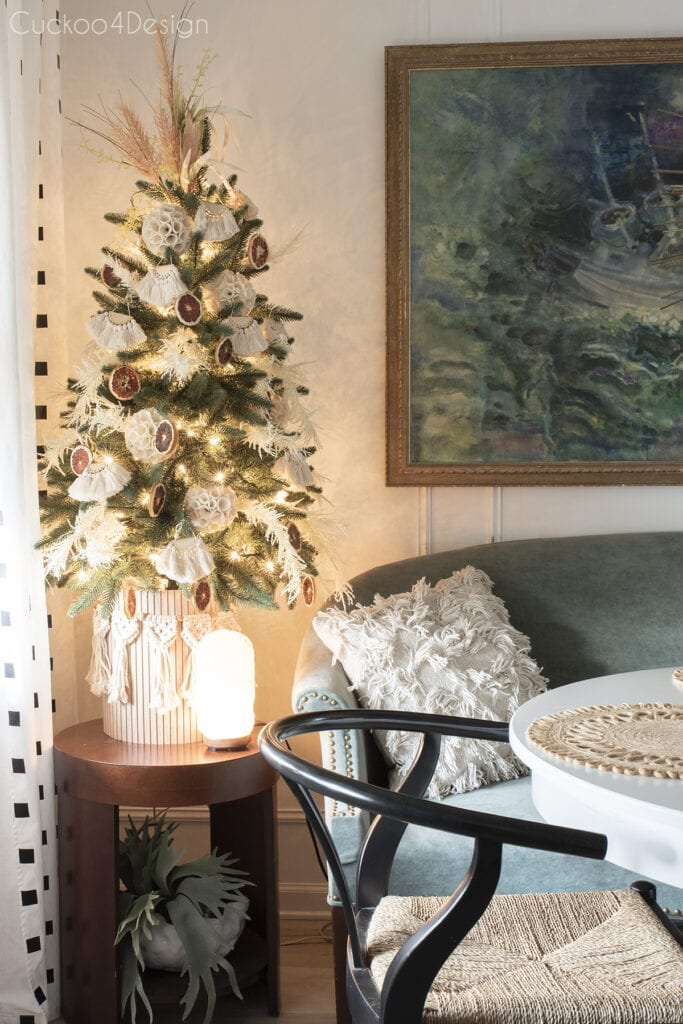 small tree decorated with grasses and macrame moved into the dining room