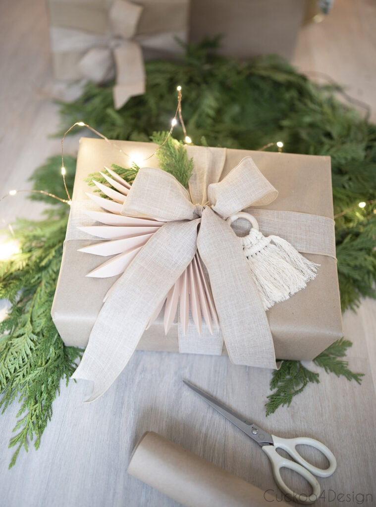 gift wrapped with brown packaging paper, linen bow and fairy lights