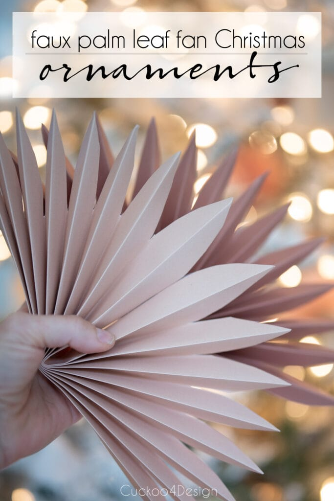 Paper fan decorations inspired by faux sun palm leaves