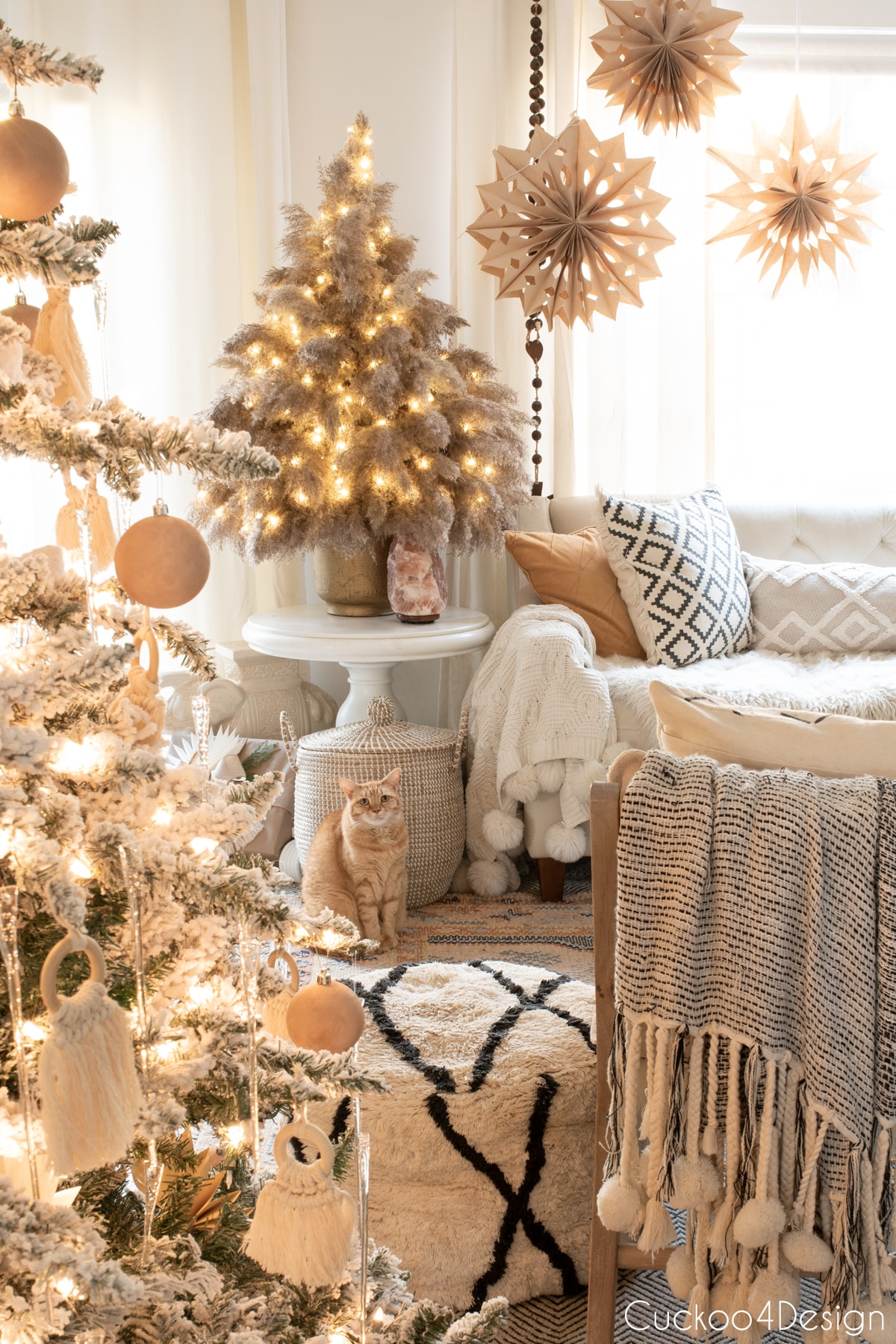pampas grass Christmas tree in matching neutral living room with orange tabby