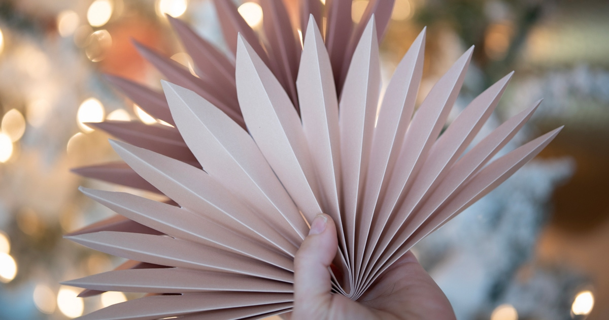 Easy and affordable paper fan decorations inspired by faux sun palm leaves