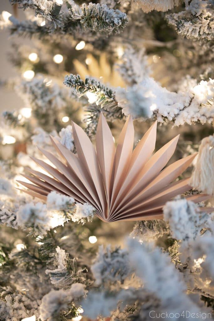 blush faux palm leaf paper fan Christmas tree decor close-up