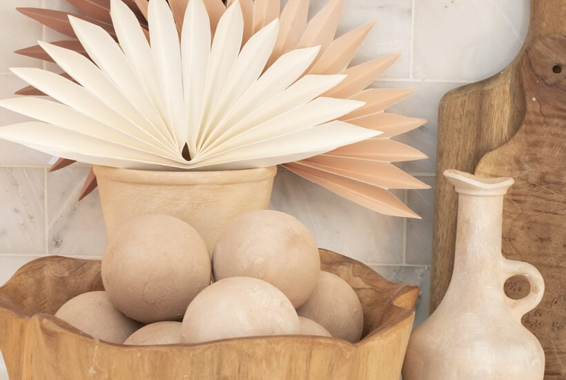 vignette of faux terracotta spheres and pottery