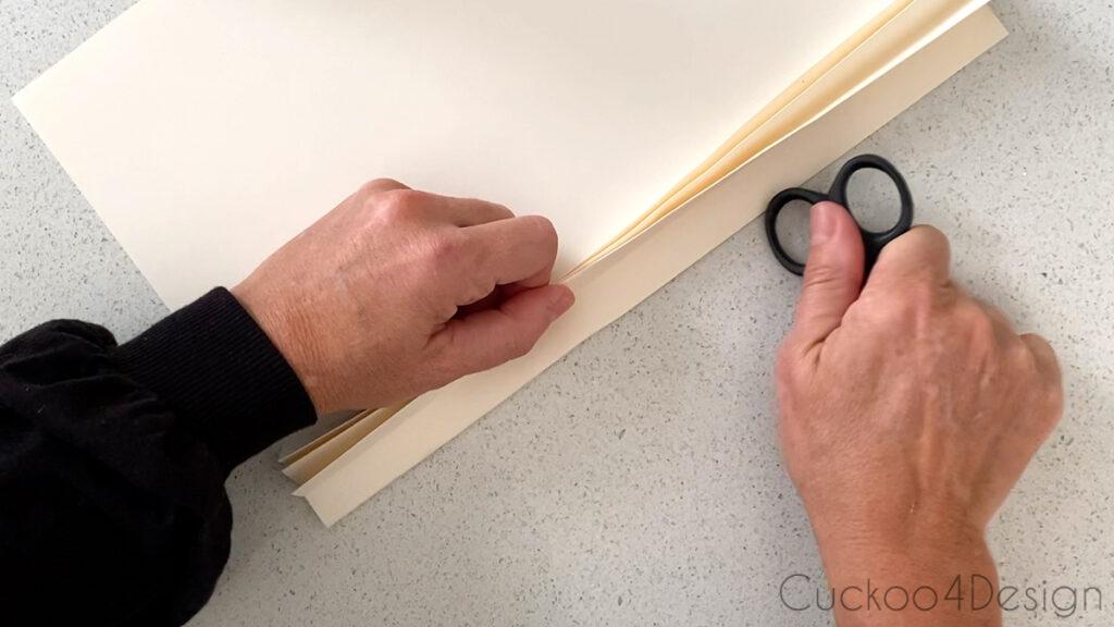 using scissors to flatten paper fan folds