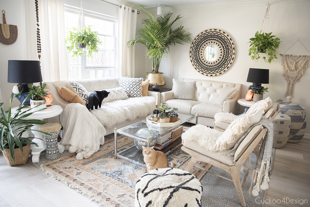 a variety of beautiful house plants in neutral boho living room