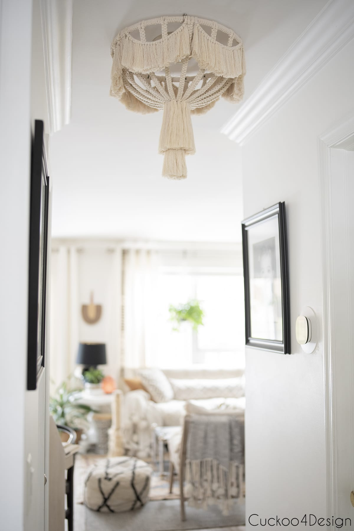 view into living room with finished macrame light fixture