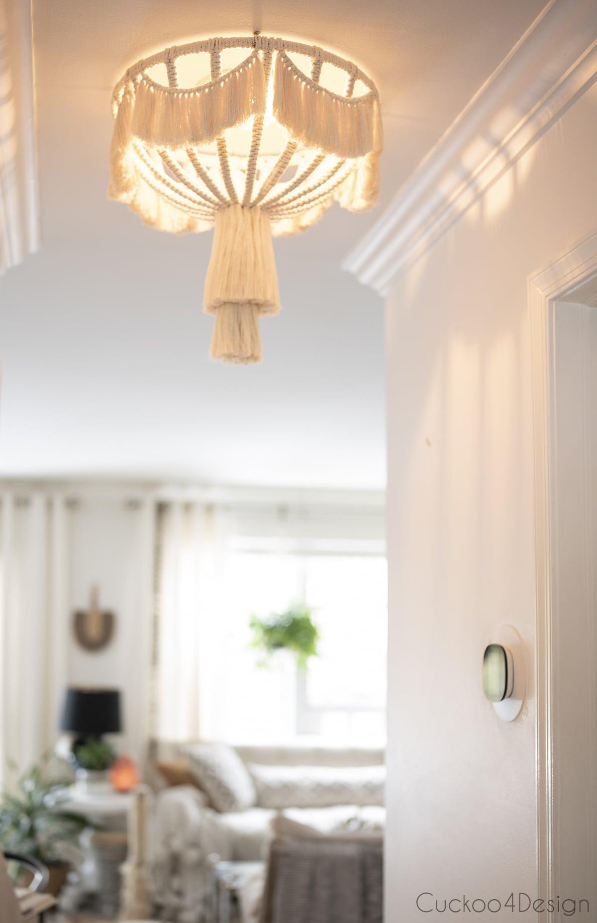 lit macrame ceiling fixture in hallway