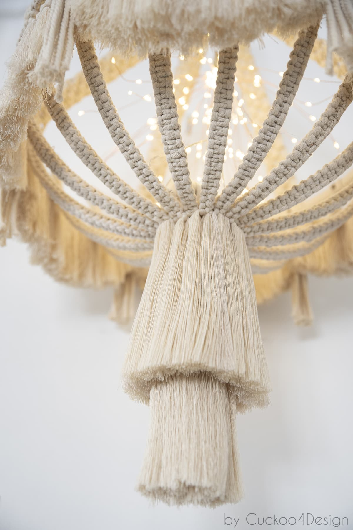 close-up of bottom of macrame chandelier with lights