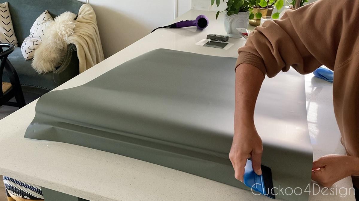 attaching vinyl car wrap with felt squeegee
