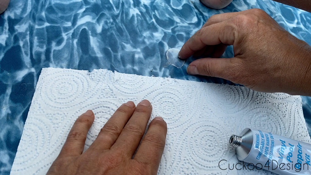 peeling off old white pool liner patch