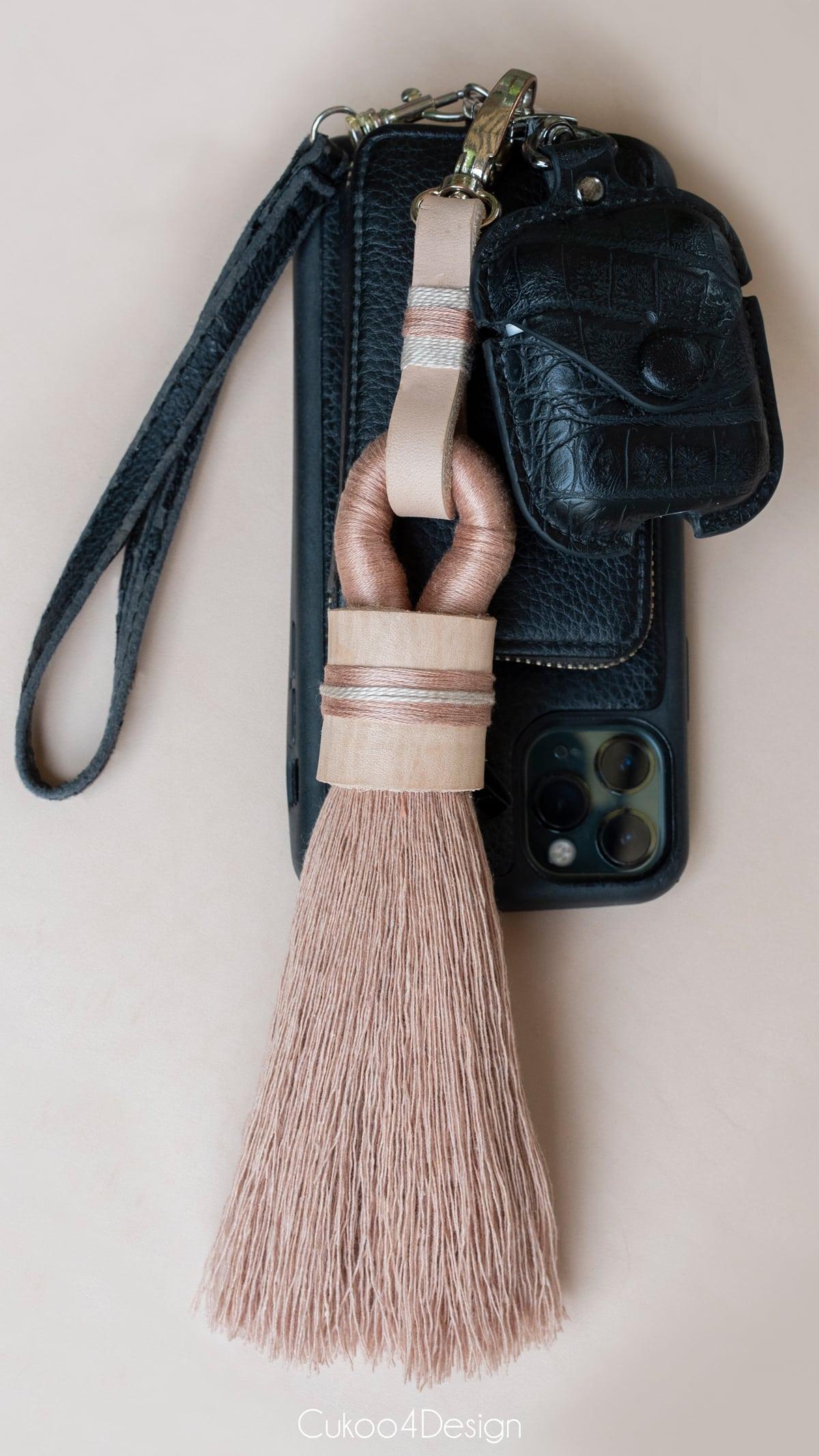 tassel keychain hanging on wristlet