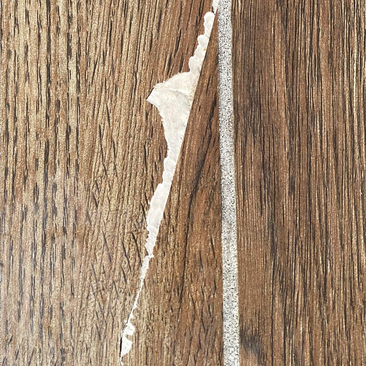 How to fix chipped tile that looks like wood