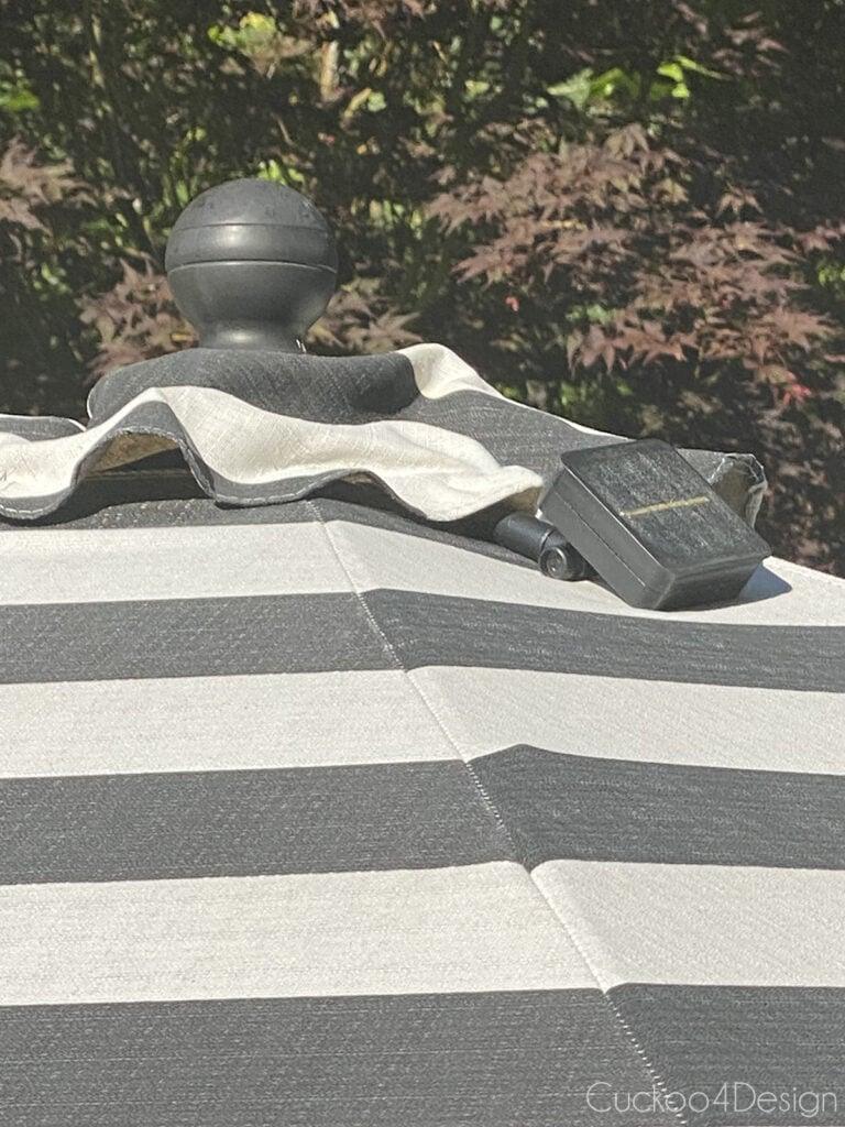 solar light box attached to patio umbrella