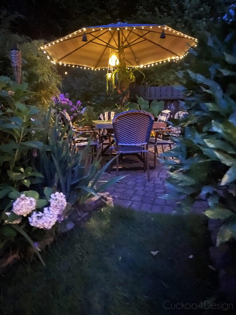 patio umbrella at night with solar fairy lights