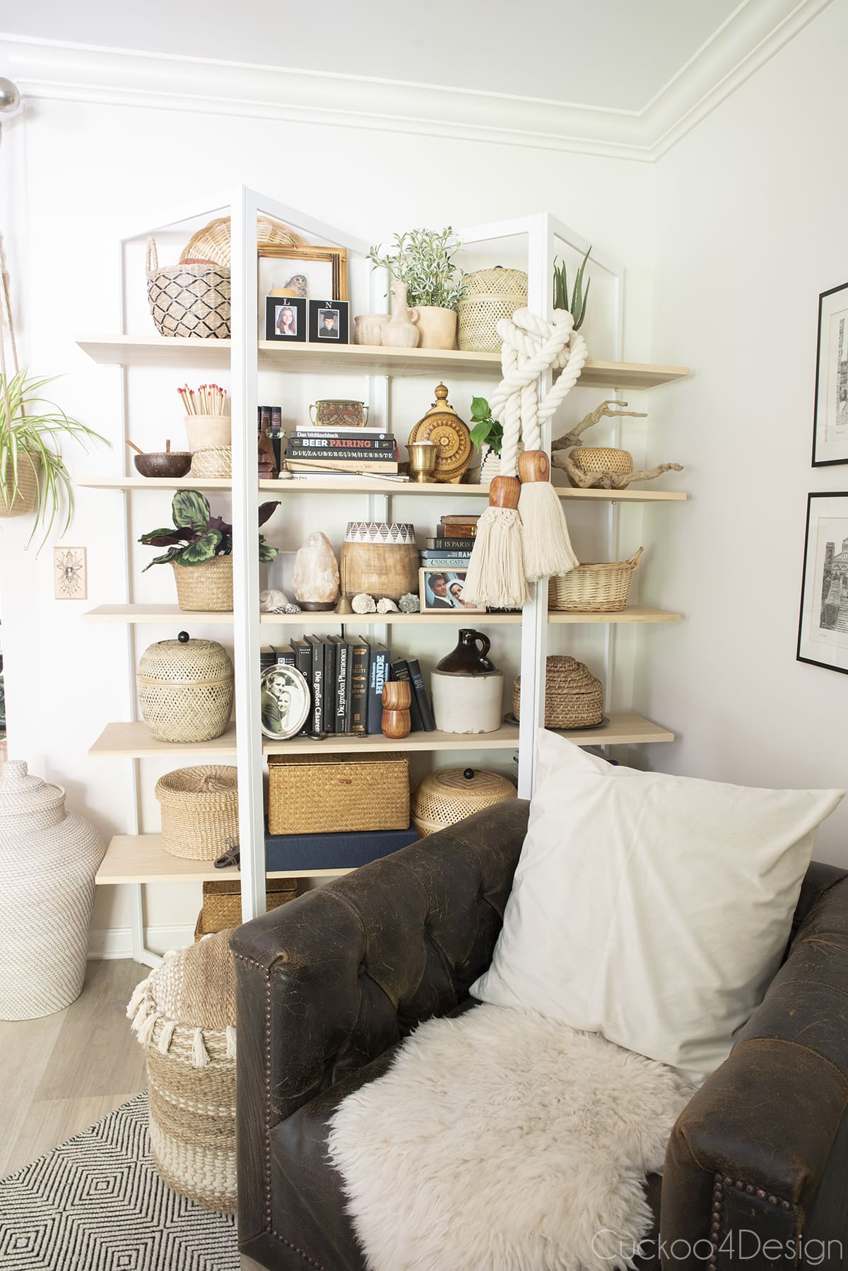 curated shelf decor with lots of baskets and plants