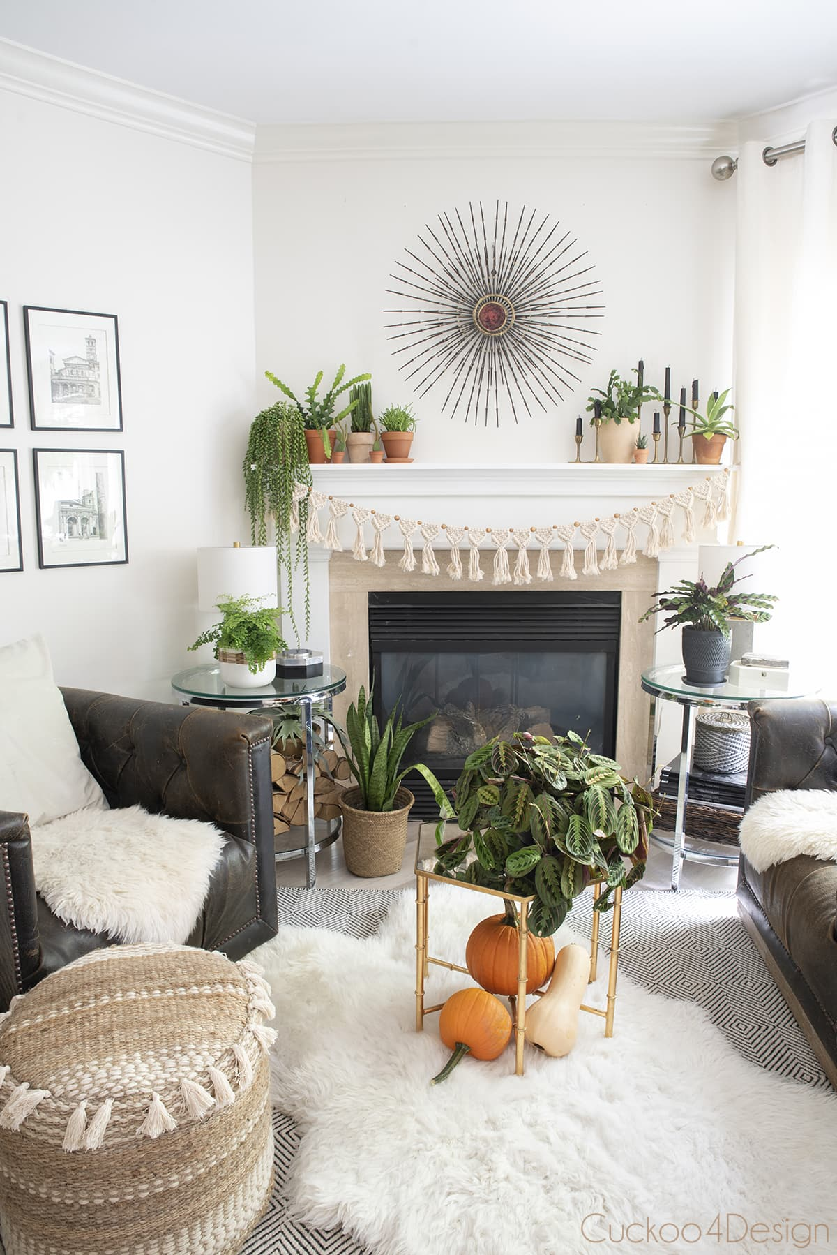 boho fall decor with lots of plants on fireplace mantle