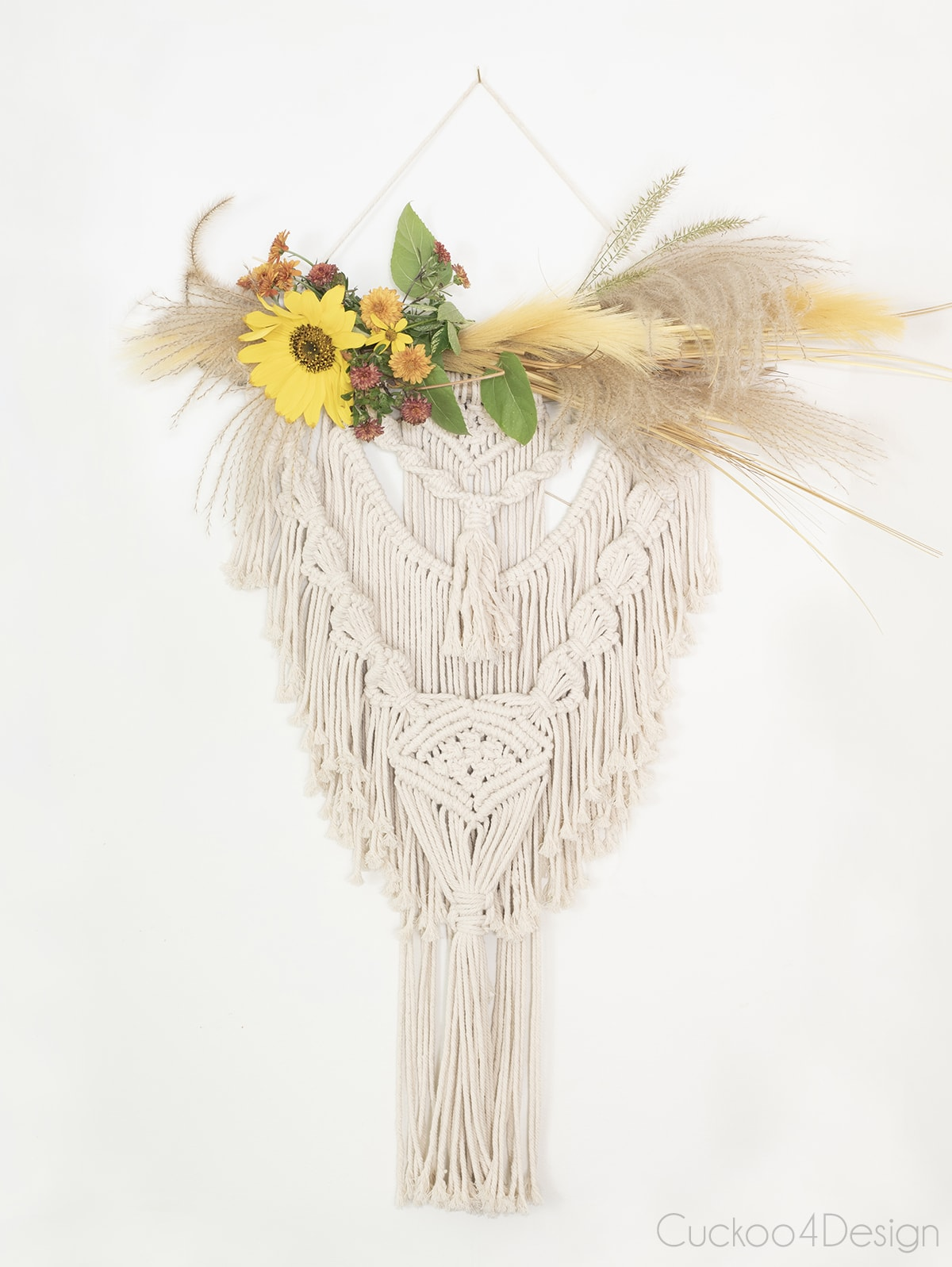 macrame wall hanging with mums, sun flowers and autumn grasses